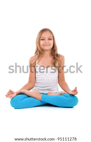 Attractive teenage girl doing yoga exercises isolated on white background