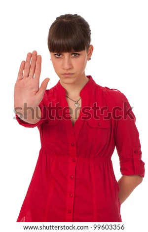 Attractive teenage girl gesturing stop sign
