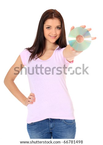 Attractive teenage girl holding dvd. All on white background.