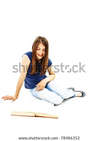 Attractive teenage girl reading a book. All on white background.