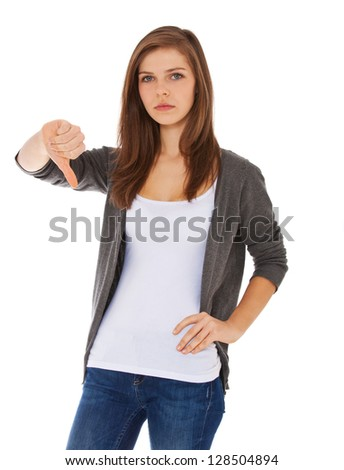 Attractive teenage girl showing thumbs down. All on white background. - stock photo
