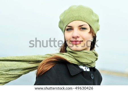 stock-photo-attractive-teenage-girl-wearing-beret-standing-outdoors-in-windy-day-49630426.jpg