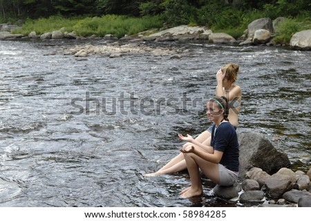 stock photo : Attractive teenage girls enjoy playing around river.