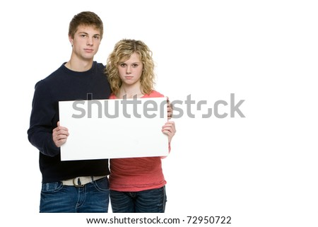 Attractive teenagers holding blank sign isolated on white background