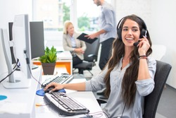 Attractive telephone worker customer service operator woman working in the office