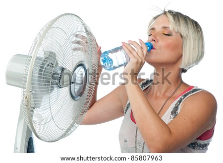 attractive thirsty woman drinks water from plastic bottle