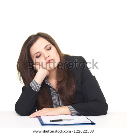Attractive tired young woman in a black jacket fell asleep near the laptop. Isolated on white background