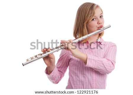 Attractive tween playing her flute.  Isolated on white.