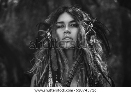 Attractive wild amazon woman in hairdress