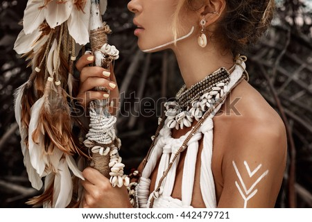 Attractive wild boho woman close up portrait