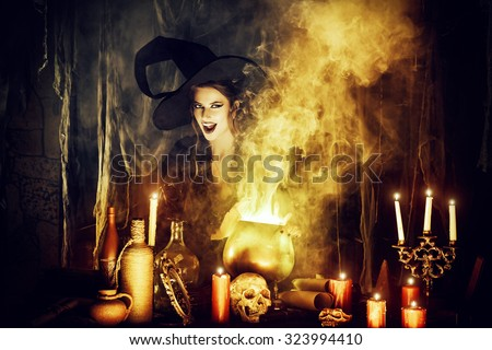 Attractive witch conjures in the wizarding lair. Fairytales. Halloween. #323994410
