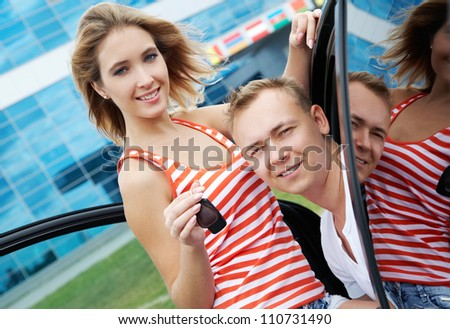 Attractive woman and man in their new modern car