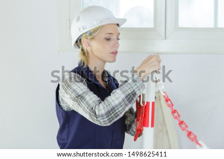 attractive woman builder concentrate on the job #1498625411