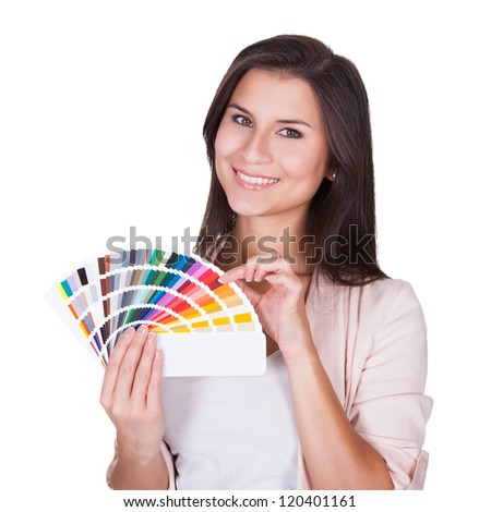 Attractive woman chooses a color scheme. Studio portrait over white