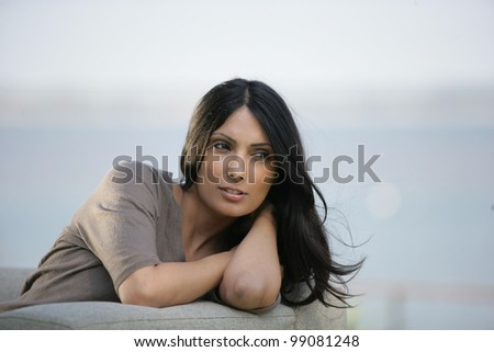 Attractive woman contemplating life