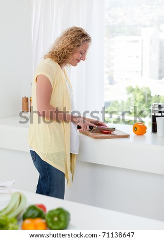 Attractive woman cooking at home
