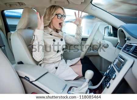 attractive woman driver road rage and panic expression