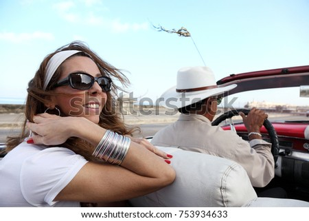 Attractive woman enjoying drive in Havana, Cuba