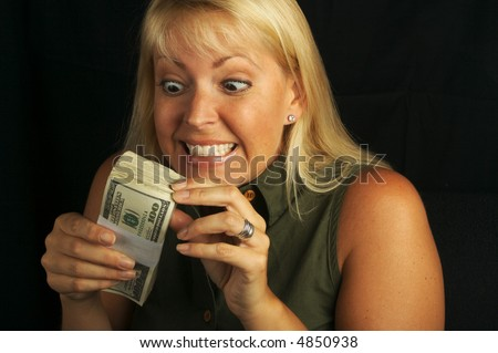 Attractive Woman Excited About her Stack of Money She Holds