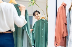 Attractive woman fitting clothed. Apparel shop.