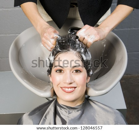 Attractive Woman Gets Spa Salon Hair Shampoo and Conditioning