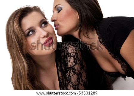 Attractive woman going to kiss her girlfriend