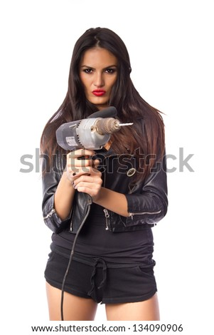 Attractive woman holding an electric drill - powertool on white background