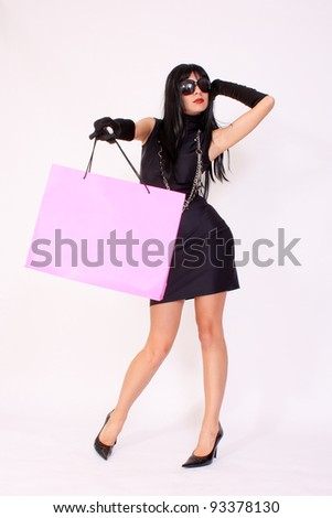 Attractive woman holding shopping paper bag