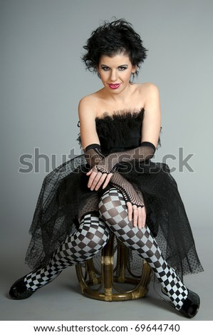 Attractive woman in black fairy dressing