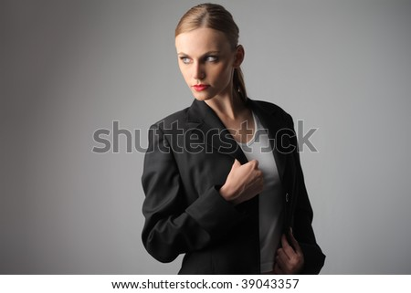 attractive woman in formal suit - stock photo