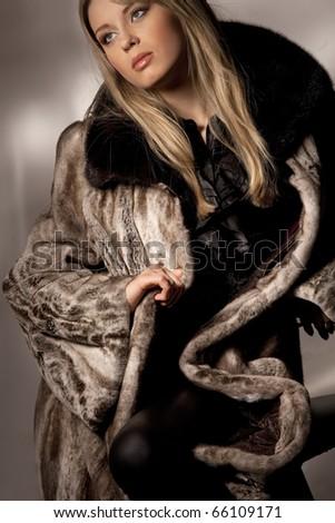 Attractive woman in fur coat