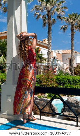 Attractive woman in greek style looking to magnificent royal garden in Greece