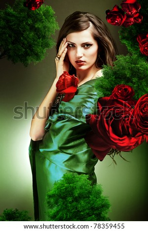attractive woman in green fabric with red roses