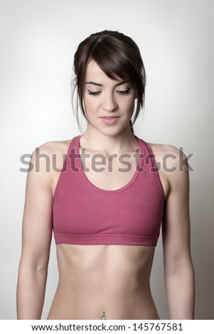 Attractive woman in gym clothes shot in the studio