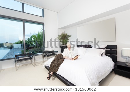 Attractive woman in modern bedroom