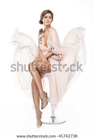 attractive woman in pink dress on white background