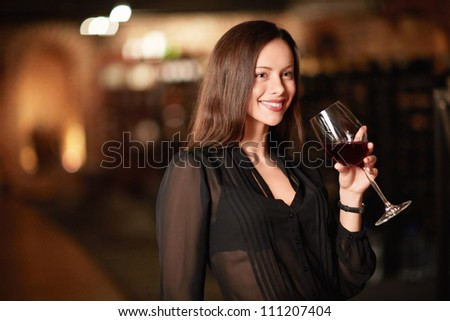 Attractive woman in the wine cellar