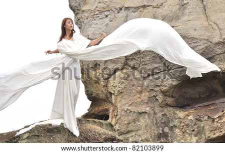 attractive woman in white dress looks like angel