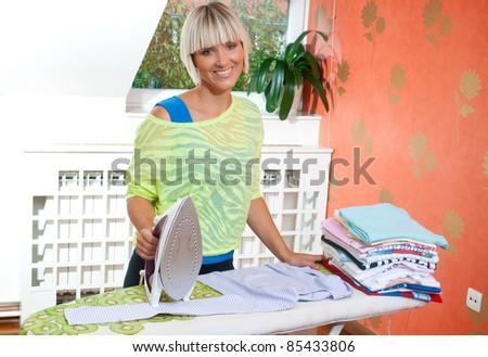 attractive woman ironing in her home