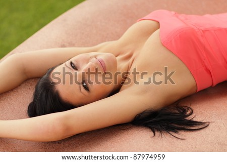 Attractive woman laying out in the park - stock photo