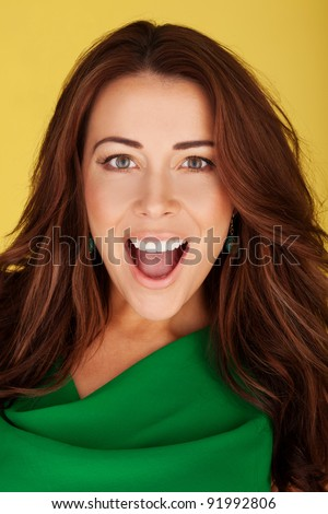 Attractive woman looking at the camera in amazement and awe with mouth open and animated expression.