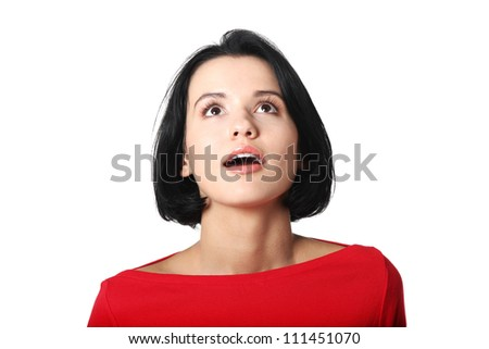 Attractive woman looking up - stock photo