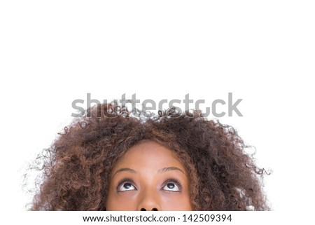 Attractive woman looking up on white background #142509394