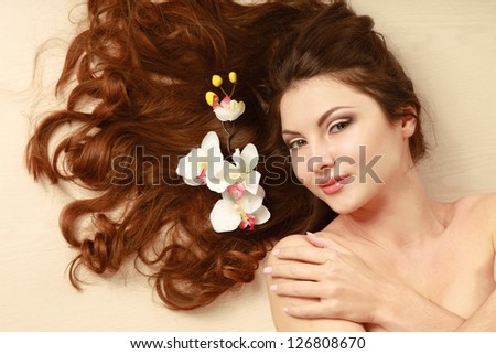 attractive woman lying on white background