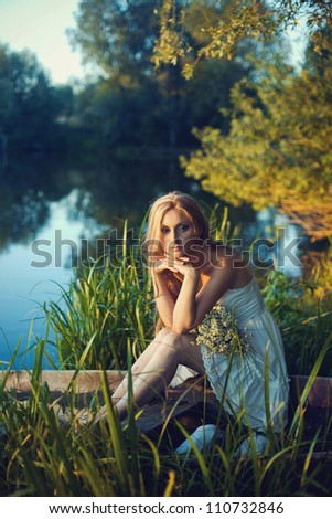 attractive woman on bow of boat