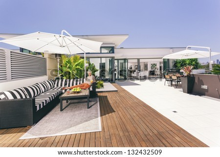 Attractive woman on luxurious penthouse balcony
