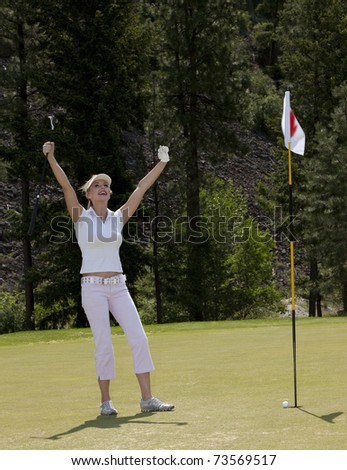 Attractive woman on putting green.