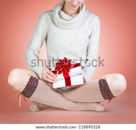 attractive woman opens a gift box