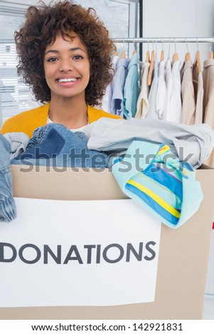 Attractive woman participating at charity and holding donation box