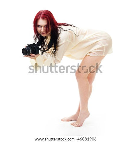 Attractive woman photographer posing, standing in wet clothes, isolated